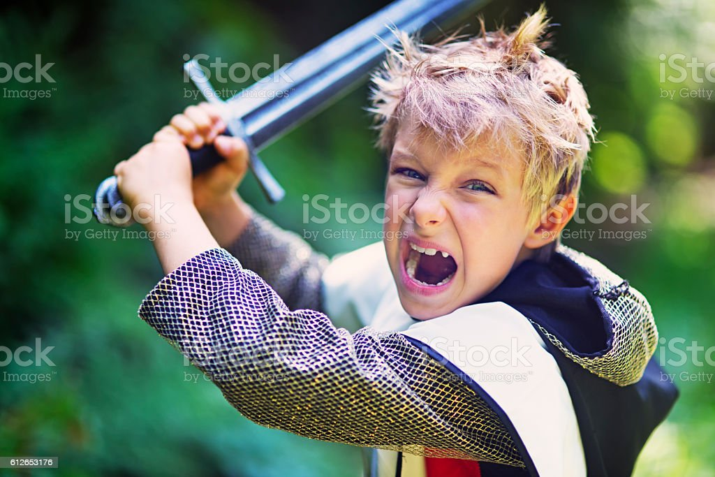 Little knight attacking with sword stock photo