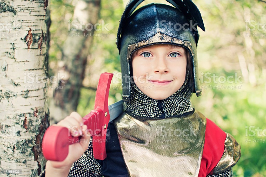 Little knight in woods royalty-free stock photo