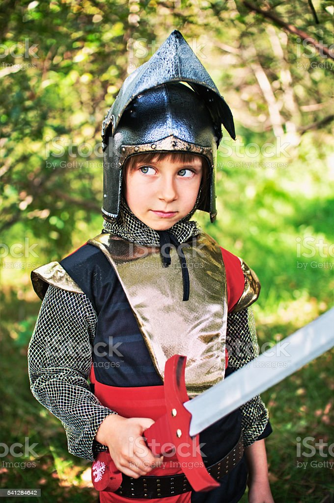 Little knight in woods stock photo