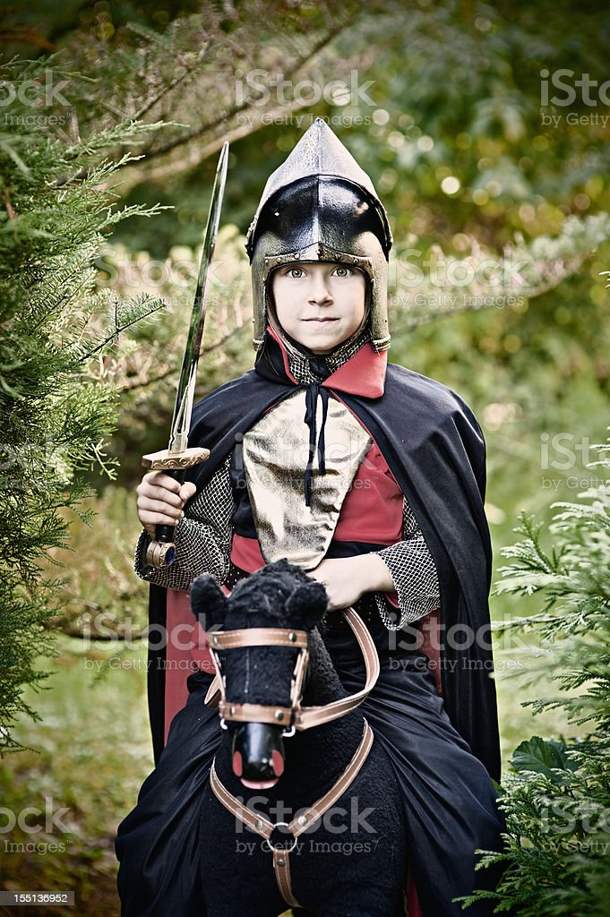 Little knight riding through the woods royalty-free stock photo