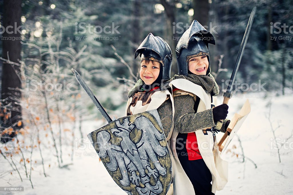 Little knights in frozen forest stock photo