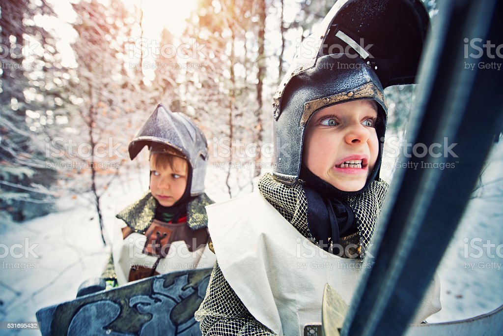 Little knights quest in frozen winter forest stock photo