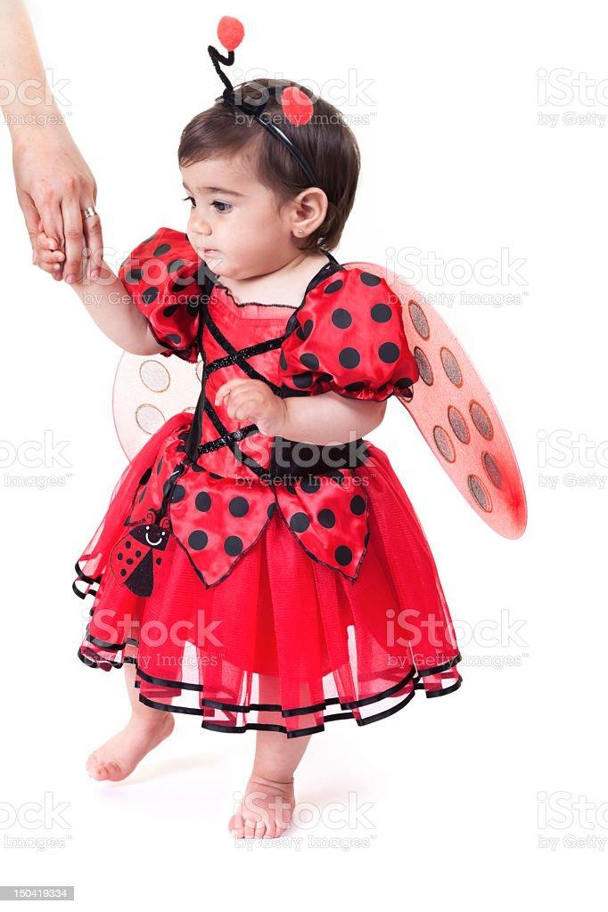 Little Ladybug holding mother hand stock photo