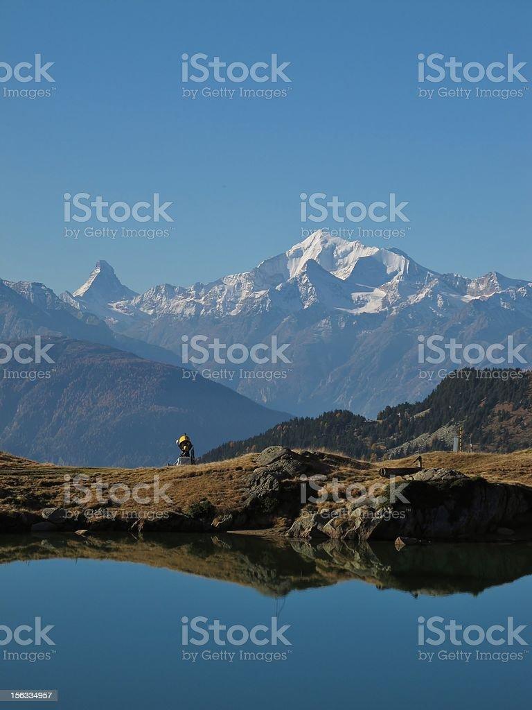 Little Lake And Mountain Peaks stock photo
