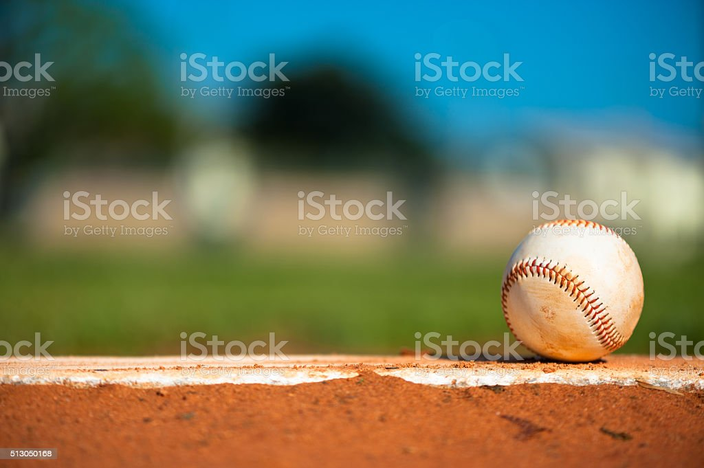 Little League Baseball on Pitching Mound Close Up stock photo