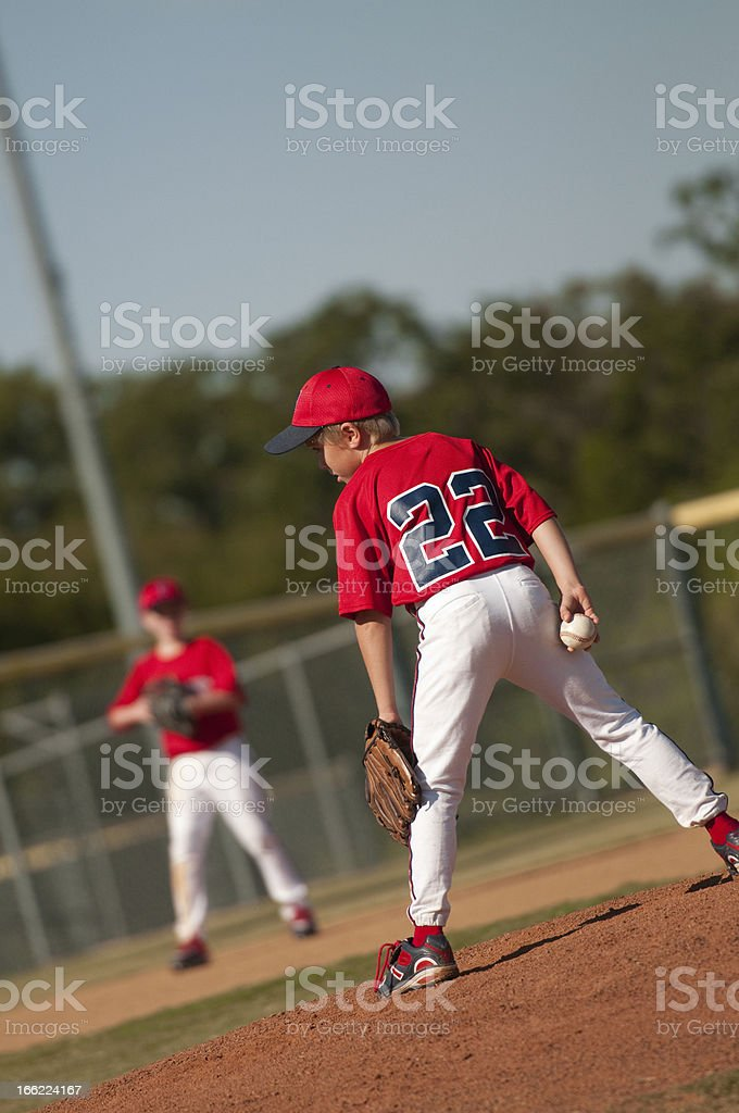 Little league baseball pitcher looking at batter. royalty-free stock photo