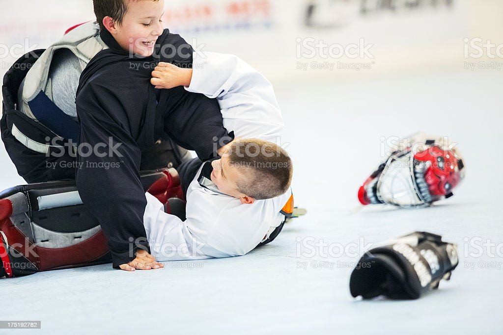 Little league kids roller hockey training, fighting royalty-free stock photo