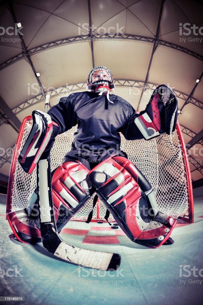 Little league roller hockey goalkeeper in training royalty-free stock photo