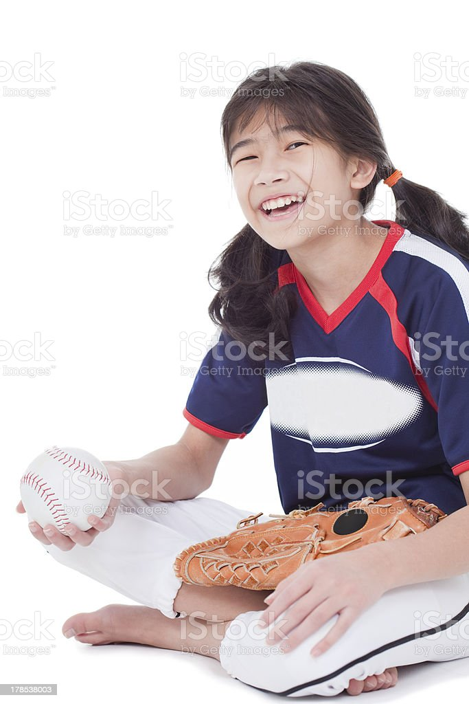 Little league softball player holding ball royalty-free stock photo