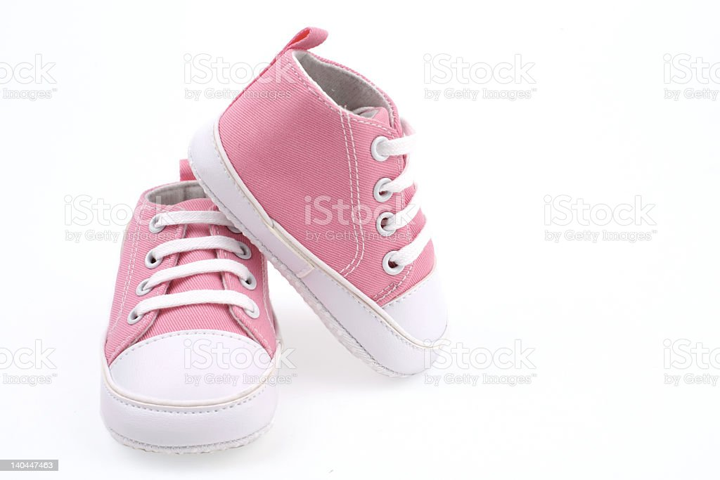Little light pink shoes for babies stock photo