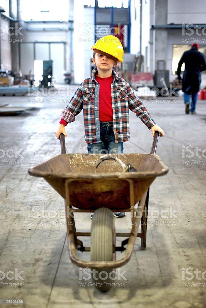 Little Manual Worker with Wheelbarrow stock photo