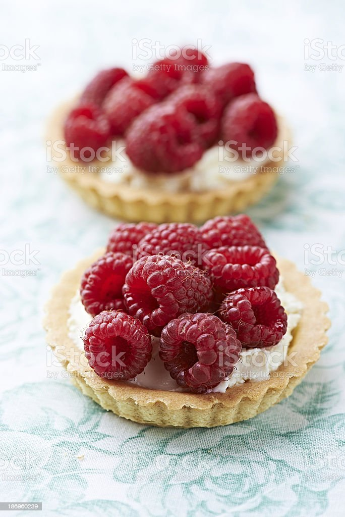 Little mascarpone tart with raspberries stock photo