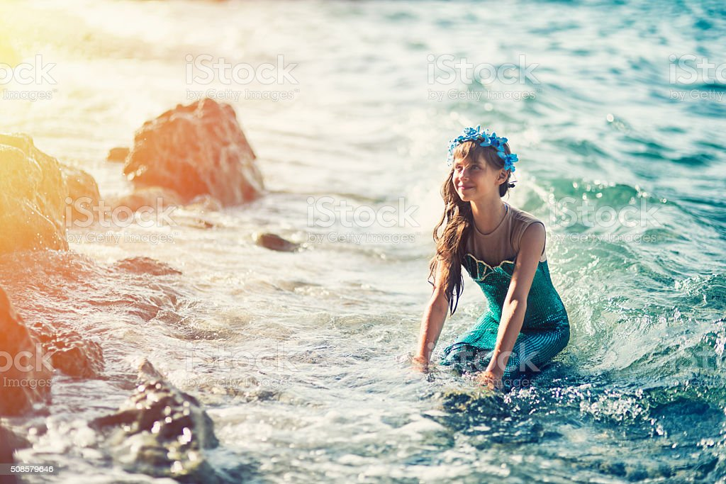 Little mermaid at the shore stock photo
