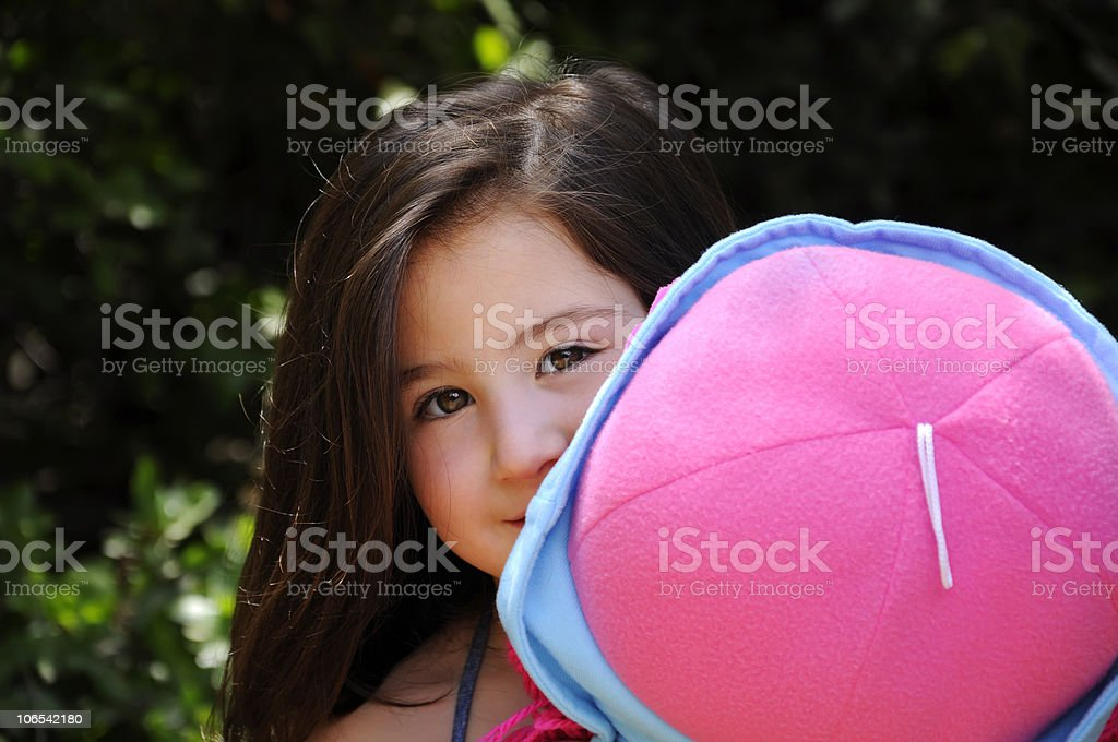 Little model with big doll stock photo