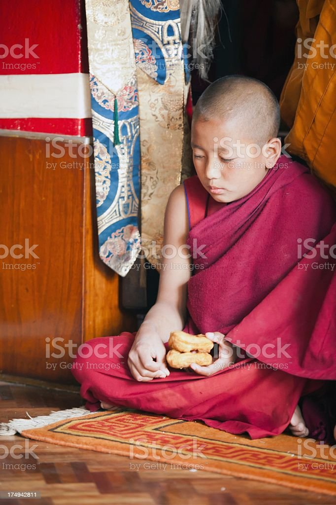 Little Monk Eating royalty-free stock photo