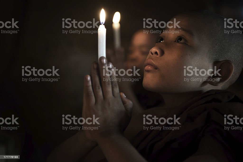 Little monks praying stock photo