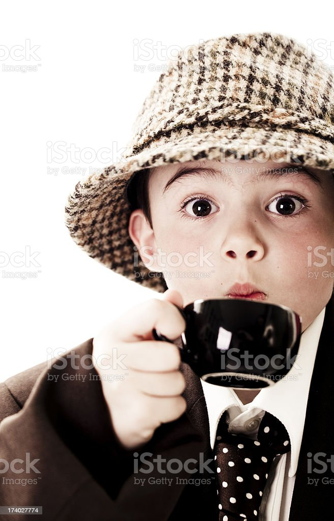 Little Monsieur drinking coffee royalty-free stock photo