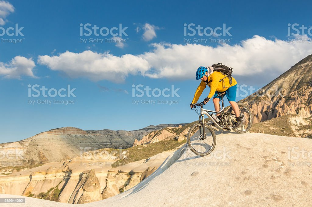 Little mountainbike dip on Cappadocian tuff formations, Turkey stock photo