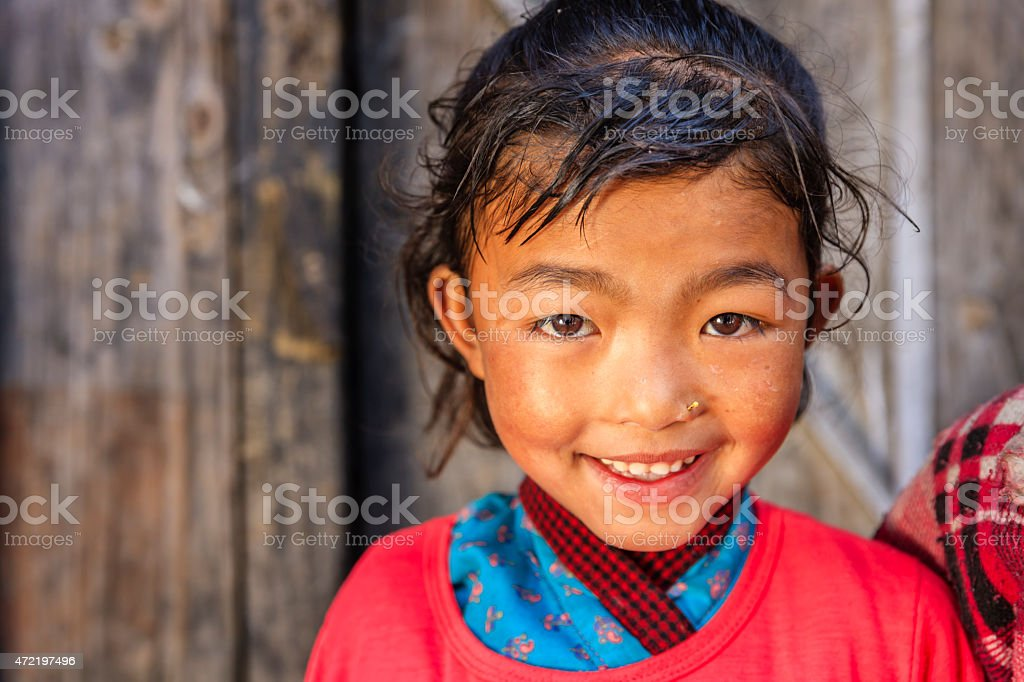 Little Nepali girl in village near Annpurna Range, Nepal stock photo