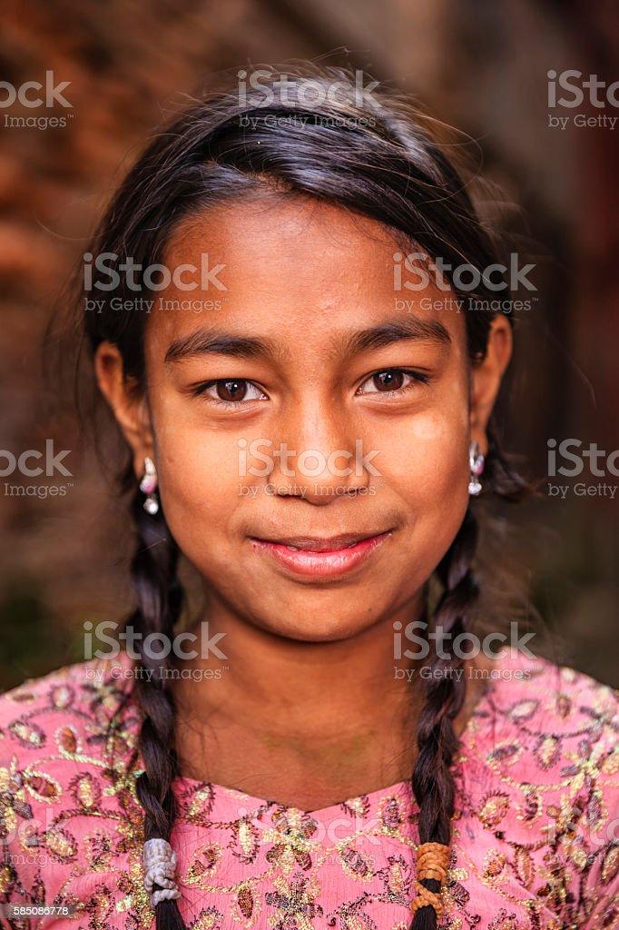Little Nepali girl posing in Bhaktapur stock photo
