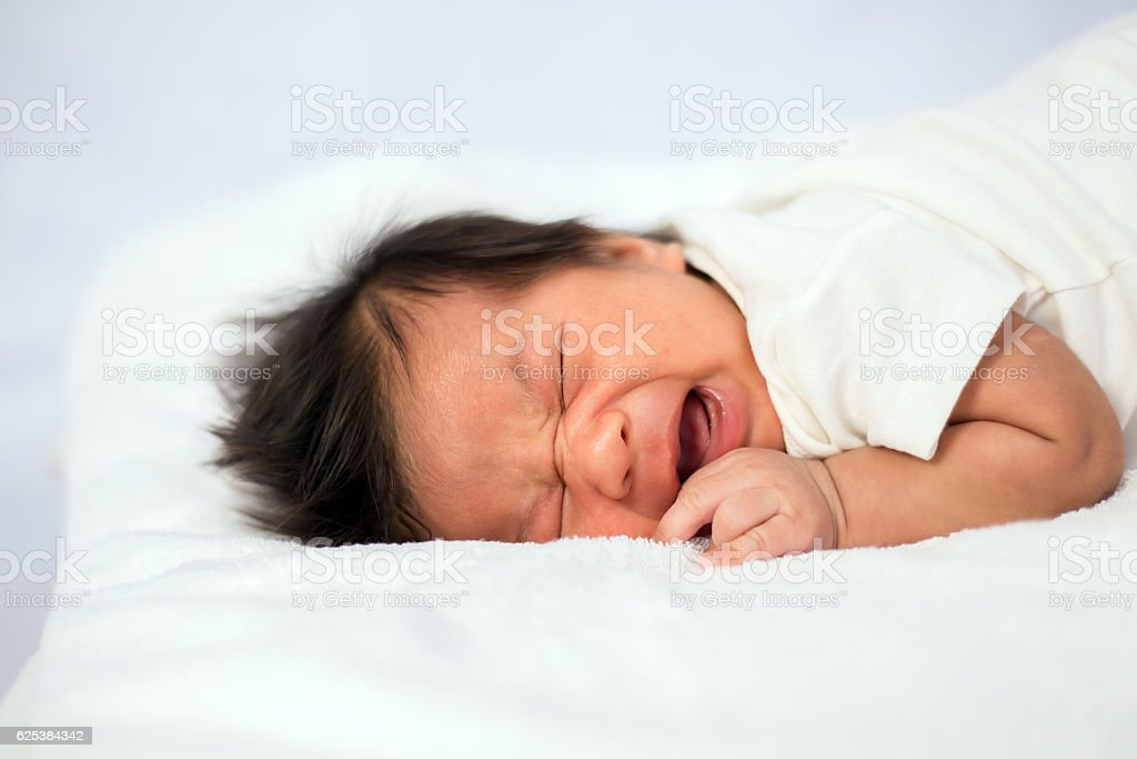Little newborn baby boy crying stock photo