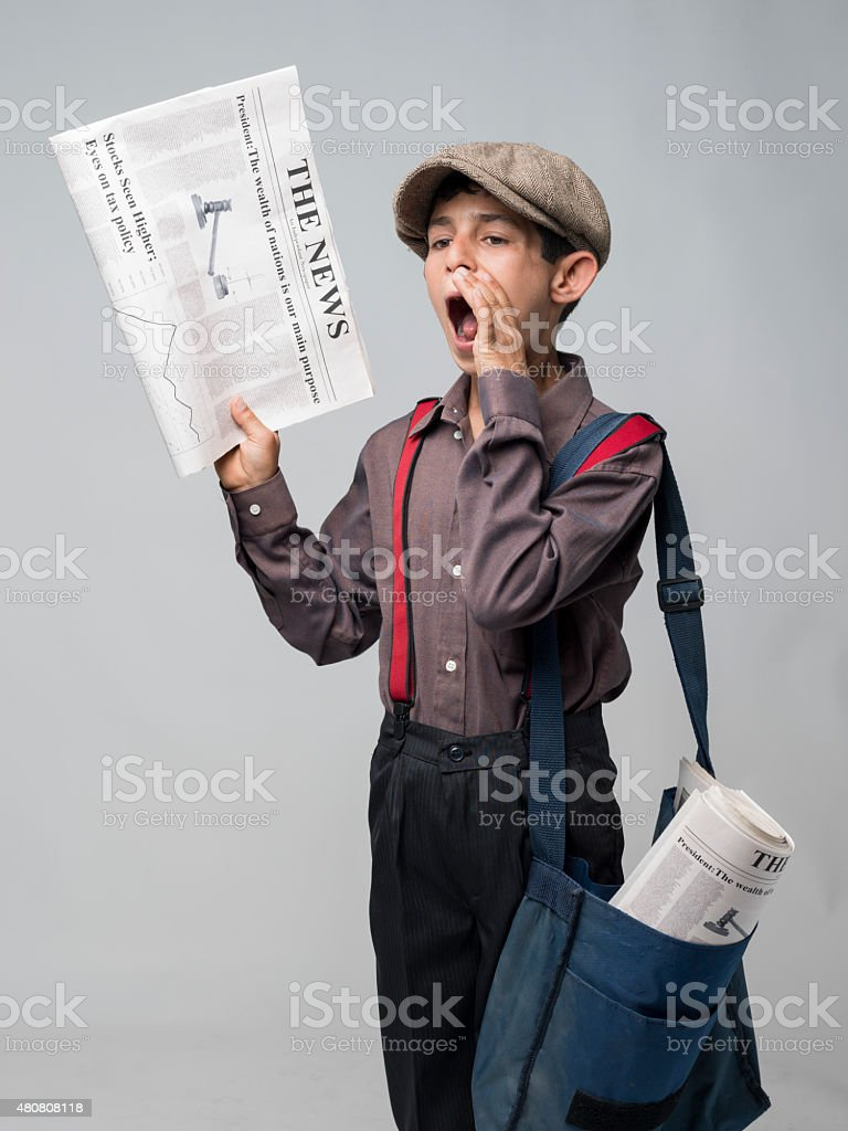 Little Newsboy Holding Newspapers And Shouting To Sell stock photo