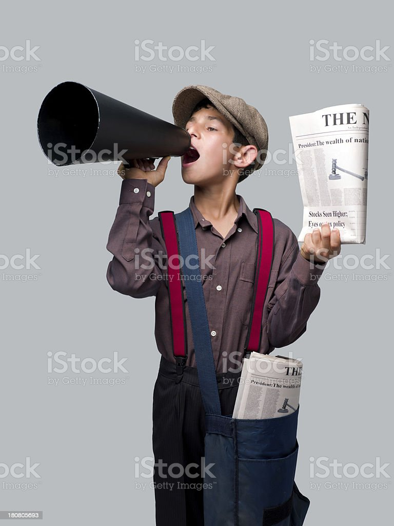 Little Newsboy Holding Newspapers And Shouting With Megaphone To Sell stock photo
