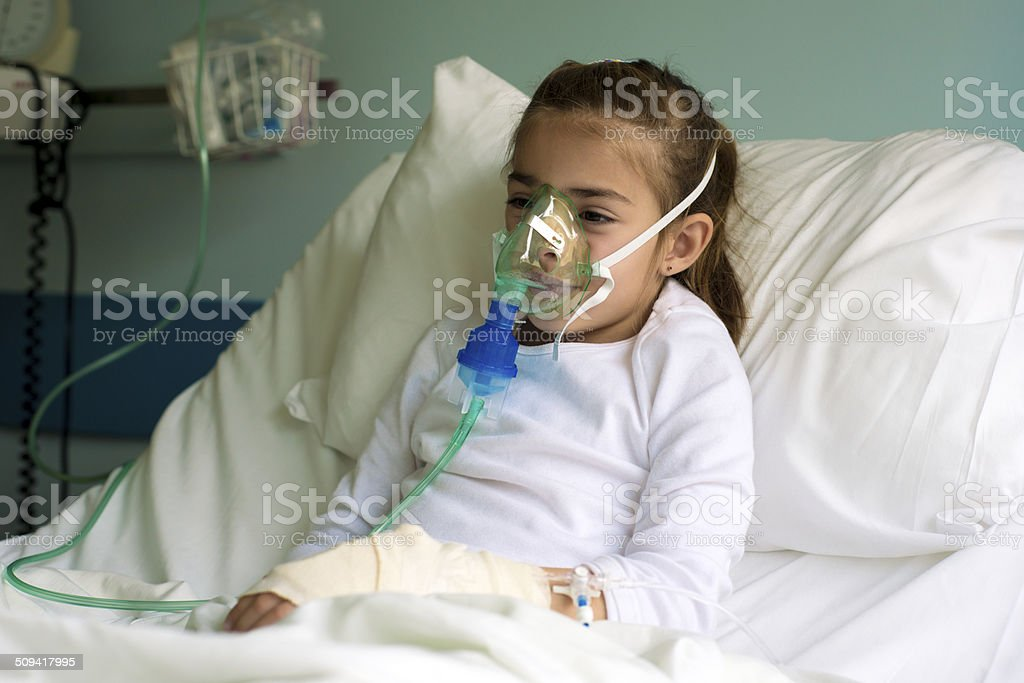 Little patient with inhalation mask stock photo