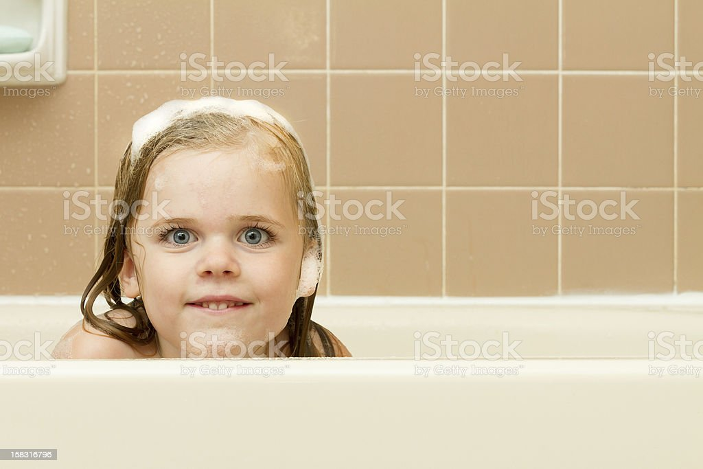Little peek and a tiny smile stock photo