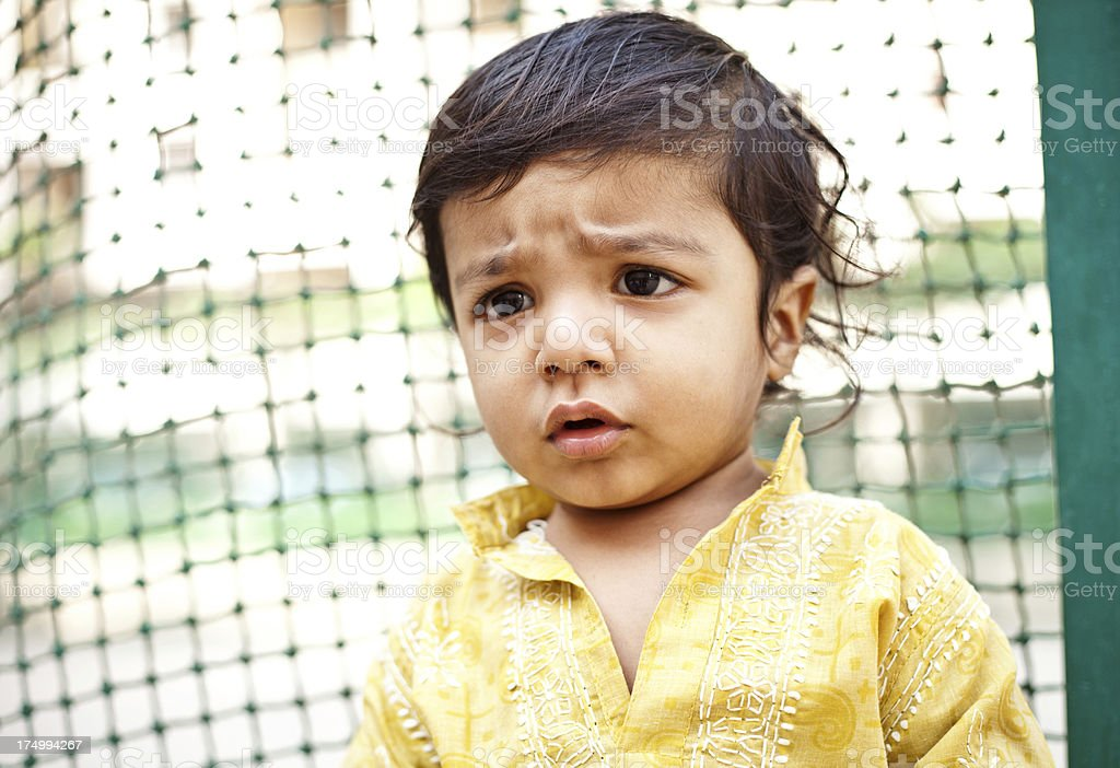 Little Pensive Asian Indian Boy Child Baby royalty-free stock photo
