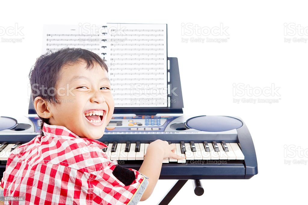 Little piano player stock photo