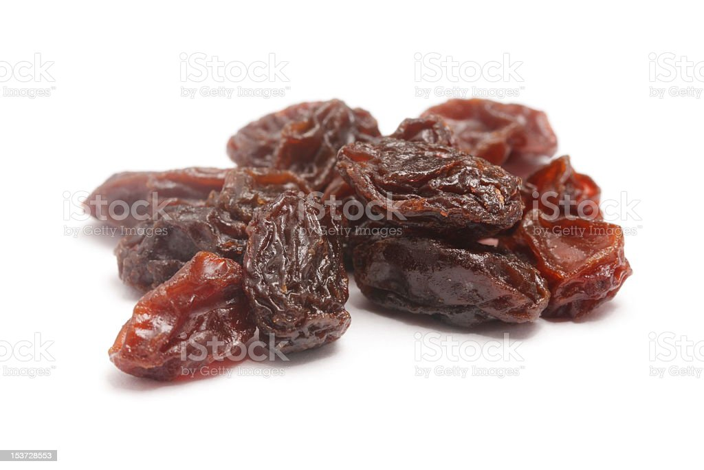 Little pile of raisins isolated on white stock photo
