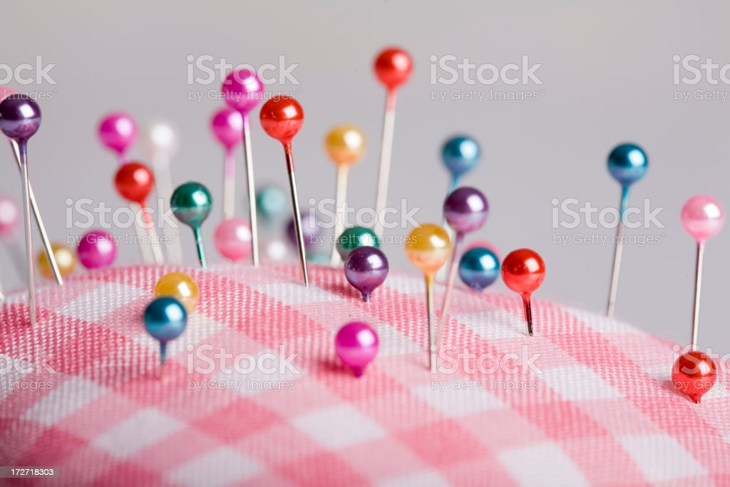 Little pillow with many pins royalty-free stock photo