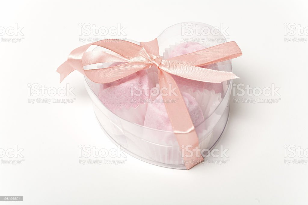Little pink cakes in a heart shaped box over white royalty-free stock photo
