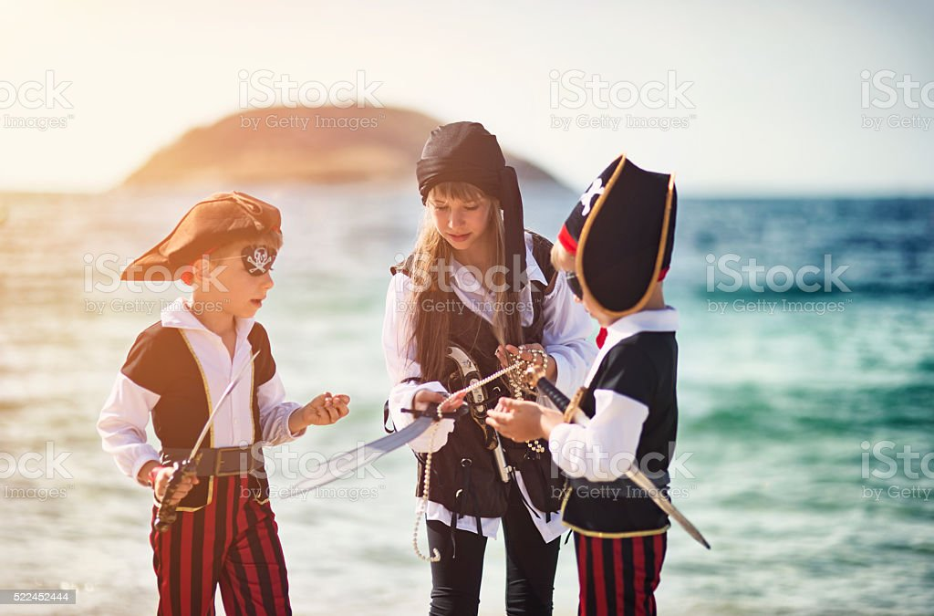 Little pirate kids diving the treasure stock photo