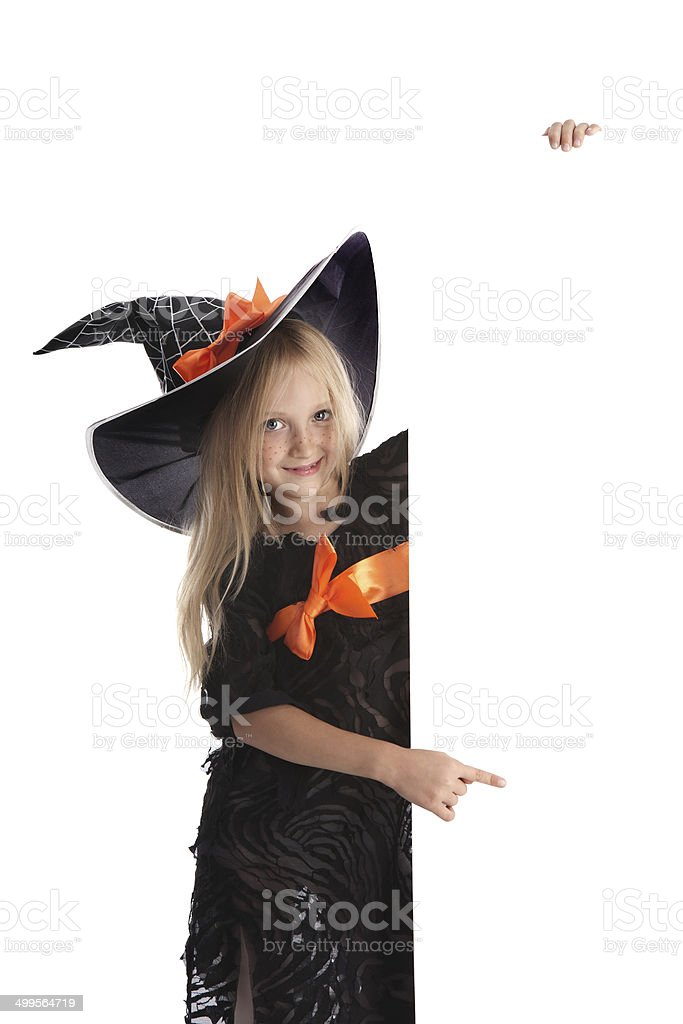 Little Playful Witch Holding a Sign . royalty-free stock photo