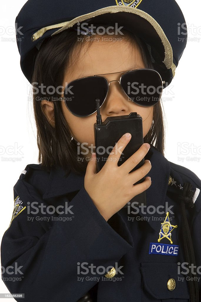 Little police officer with walkie talkie stock photo