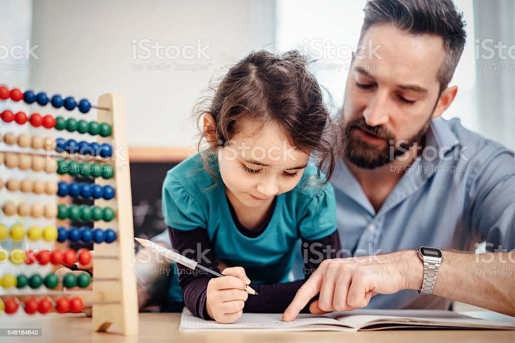 little pre-scholar girl and father learning calculating at home stock photo
