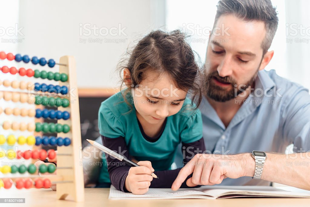 little pre-scholar girl and father learning calculating with colored balls stock photo