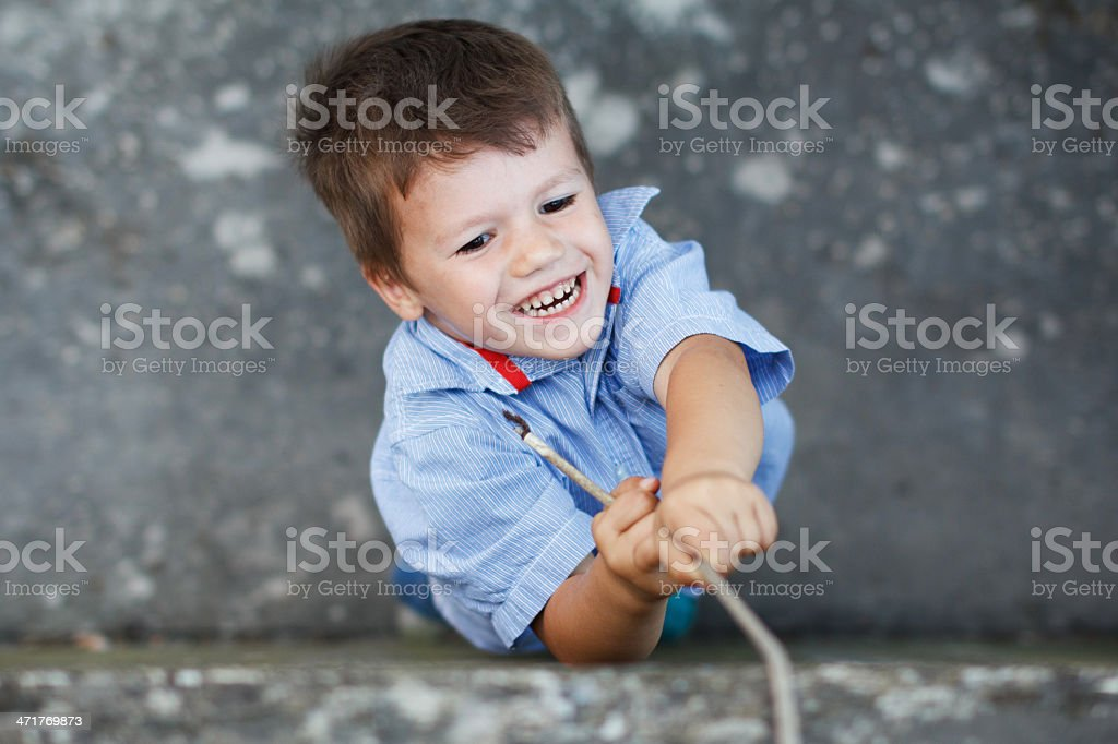 Little preschooler boy with branch royalty-free stock photo