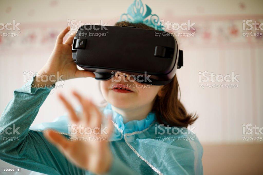 Little princess girl with virtual reality headset stock photo