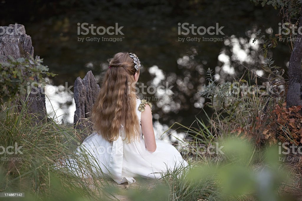 Little Princess Looking At Stream Reflection royalty-free stock photo