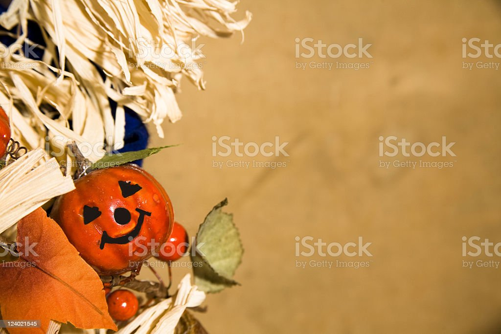 Little pumpkin with face helps create  great background for fall royalty-free stock photo