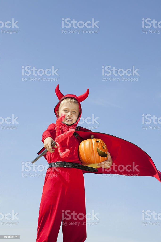 Little Red Devil Standing with a Trident. royalty-free stock photo