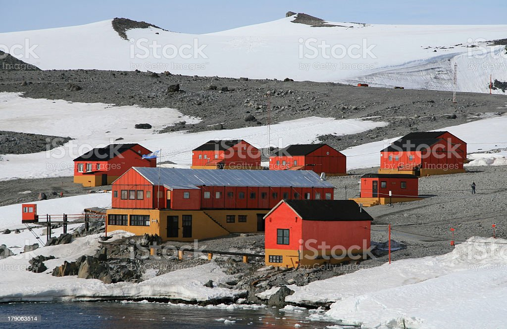 Little red houses and bigger one in the center in Antarctica stock photo
