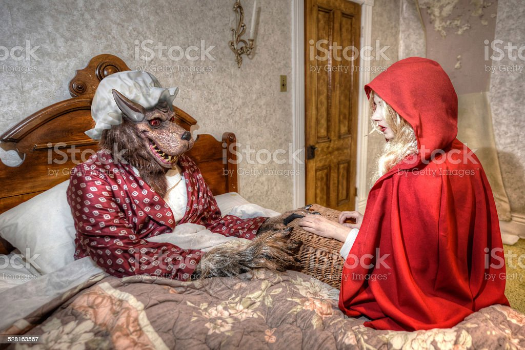 Little Red Riding Hood at Grandmas House stock photo