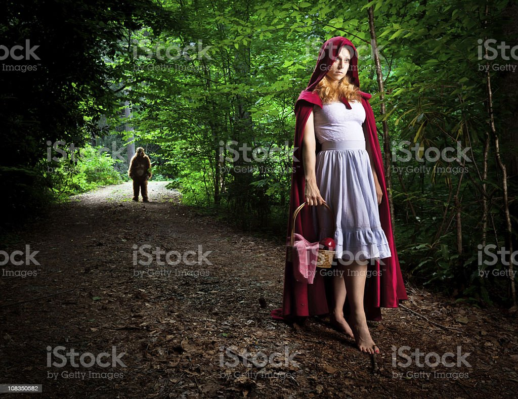 Little Red Riding Hood lost in the forest royalty-free stock photo