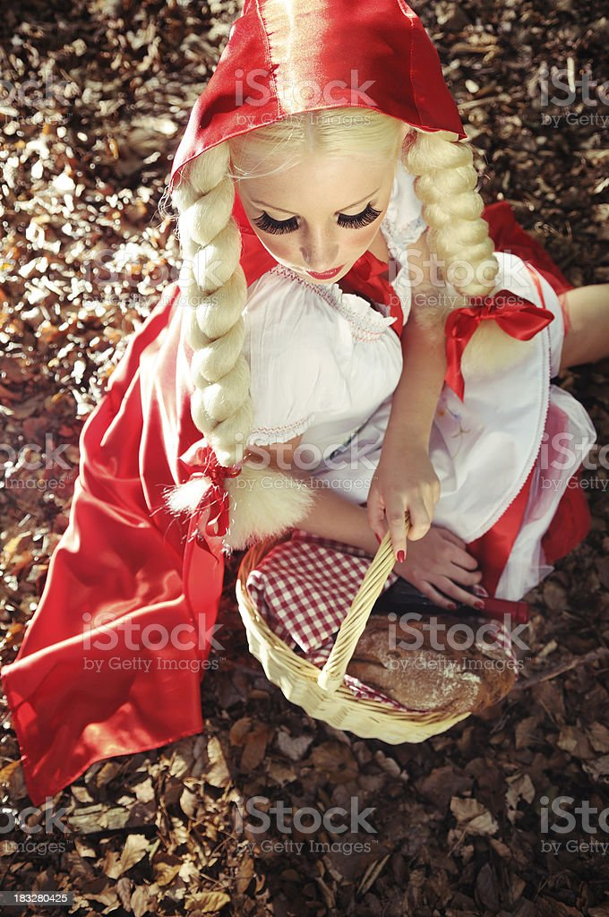 Little Red Riding Hood Resting In The Forest stock photo