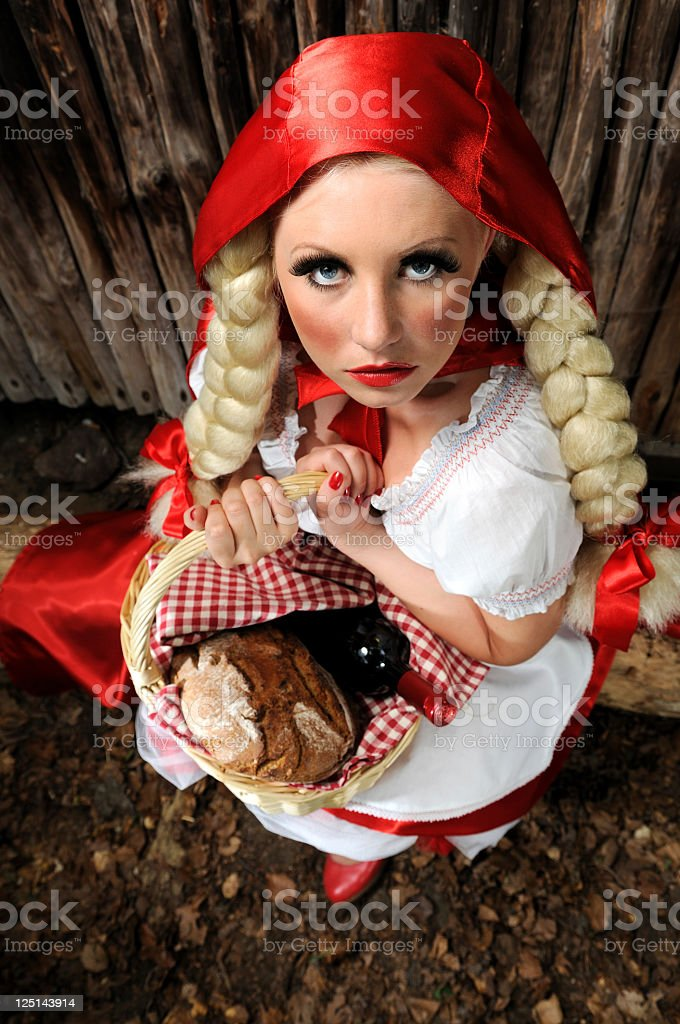 Little Red Riding Hood Sitting On A Log stock photo