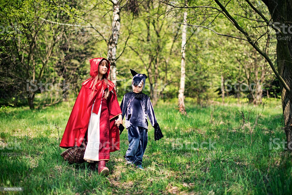 Little Red Riding Hood walking with Big Bad Wolf stock photo